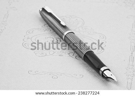 black fountain pen on the notebook - stock photo