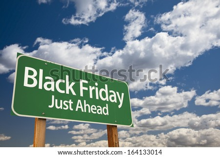 Black Friday Just Ahead Green Road Sign with Dramatic Clouds and Sky. - stock photo