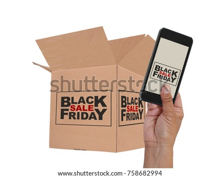 Black Friday Sale on cell phone screen held by hand in front of cardboard box  white background