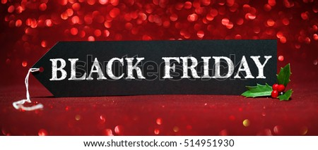 Black Friday sale tag on red glitter background