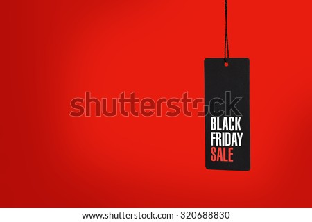 Black friday. Sale tag on the red background - stock photo
