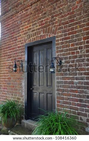 Black Front Door On Red Brick Stock Photo 108416360