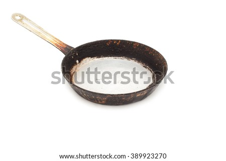 Black frying pan isolated on a white background  - stock photo