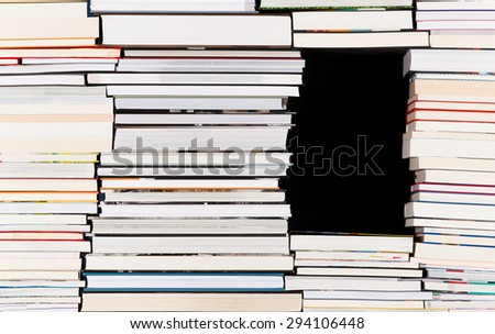 Black gap in a pile of books