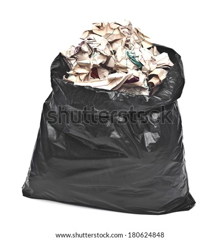 black garbage bag with trash isolated on white  - stock photo