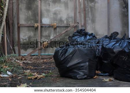 Black garbage bags. - stock photo