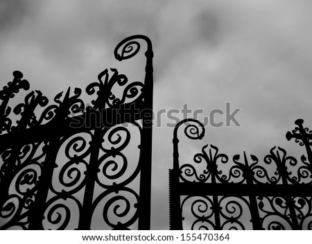 Black gates against sky - stock photo