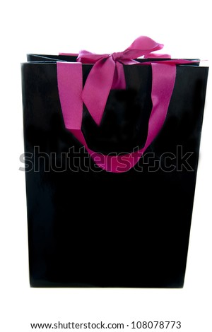black gift bag with pink ribbons on a white background