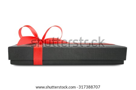 Black gift box (present) with red satin ribbon bow, side view, isolated on white background