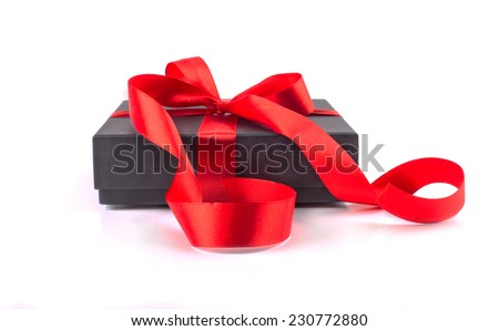 Black gift box with red bow and ribbons on a white background - stock photo