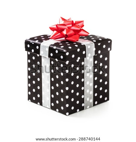 Black gift box with white dots and red ribbon bow. Holiday present. Object isolated on white background. Clipping path - stock photo