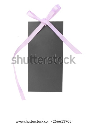 Black gift tag tied with a bow of pink satin ribbon - stock photo