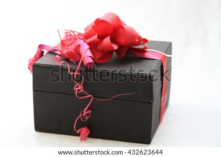 Black giftbox with red decorations