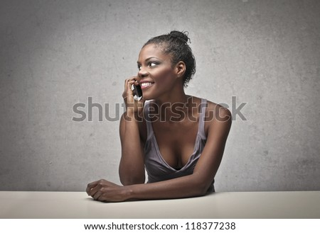 Black girl calling with a mobile phone - stock photo
