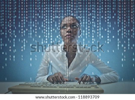 Black girl coding on the computer