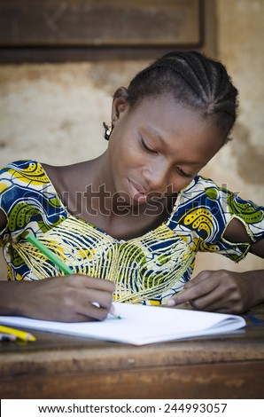 Black Girl Drawing and Writing Letters to Communicate in Africa