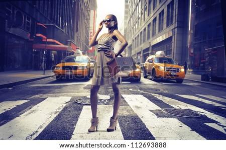 Black girl on pedestrian crossings in New York - stock photo