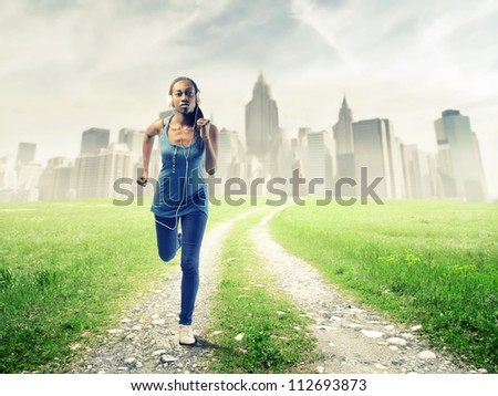 Black girl running in a field near New York