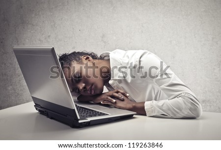 Black girl sleeping on a laptop computer