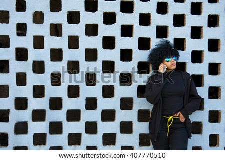 black girl talking on mobile phone - stock photo