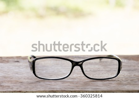 black glasses on old  wood table