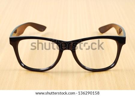 black glasses on wood  background - stock photo