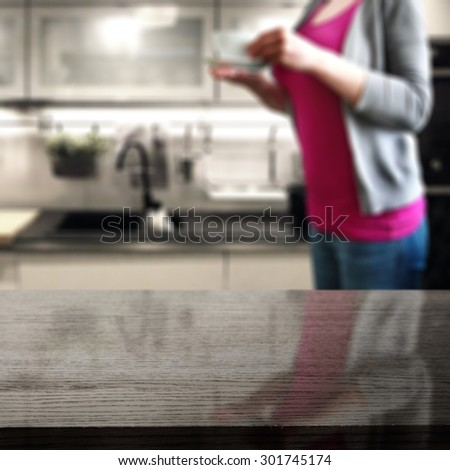 black glasses top of board and woman with coffee cup in hands
