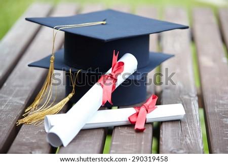 Black  Graduation Cap with Degree - stock photo
