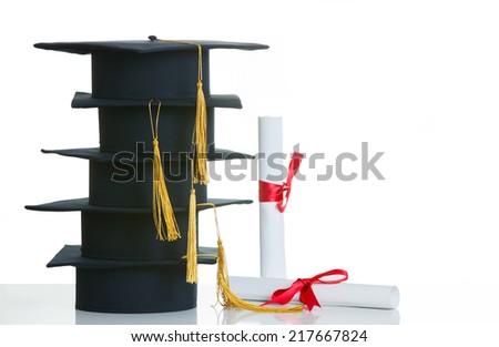 Black Graduation Cap with Degree Isolated on White Background. - stock photo