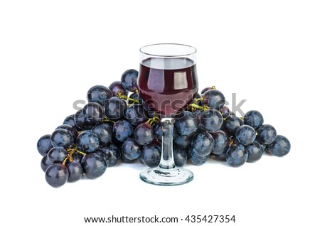 Black grape and glass of red wine isolated on white background - stock photo