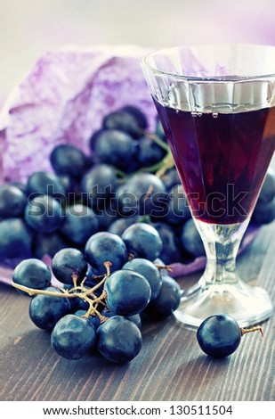 black grapes and red wine - stock photo