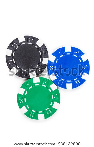 Black, green, and blue poker chips isolated on a white background