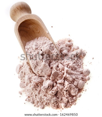 black ground salt from the Himalayas, in a wooden scoop isolated on white background