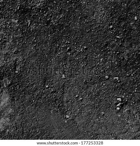 Black ground textured ground.  - stock photo