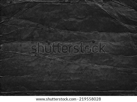 Black grunge background from old paper texture - stock photo