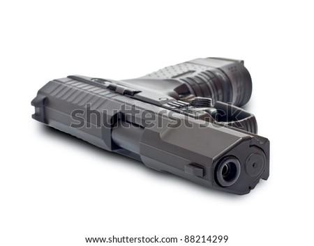Black gun lying on a white background - stock photo
