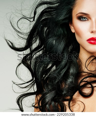 Black Hair. Fashion Girl Portrait. long  Hair and red lipstick.