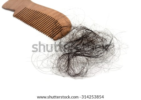 Black hair loss problem with comb on white blackgroud - stock photo