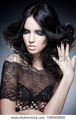 black hair young woman portrait with an original colour make-up, studio shot - stock photo
