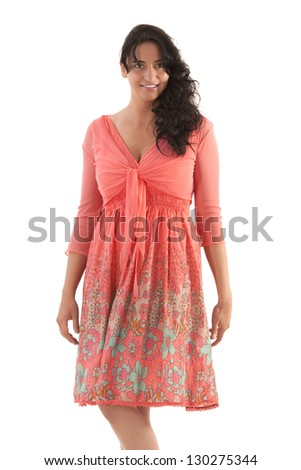 Black-haired woman in a salmon-colored summer dress / summer messenger - stock photo