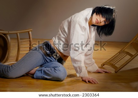 black-haired young pretty woman in studio with wooden floor