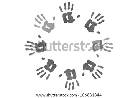 Black hand prints forming a circle against a white background - stock photo