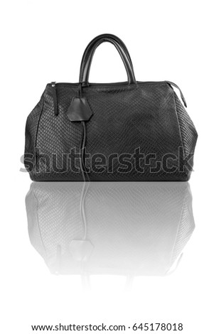 Black handbag on reflect floor.Isolated on white background.Front view.