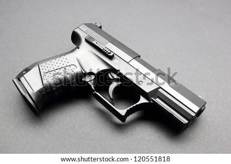 Black handgun on a black background - stock photo