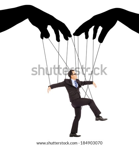 black hands shadow control a businessman action  - stock photo