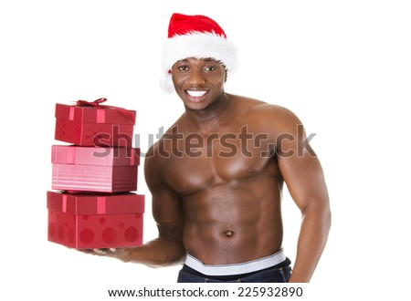 Black handsome man holding christmas gifts - stock photo