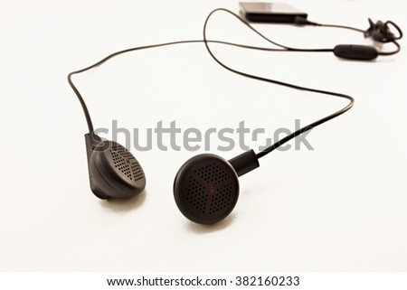 black headphones and smartphones on a white background