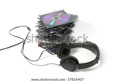Black headphones on a pile of CD on a white background