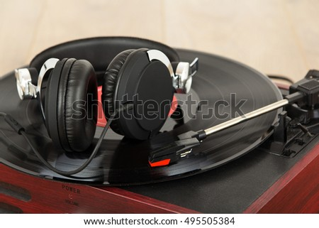 Black headphones on an old retro record player