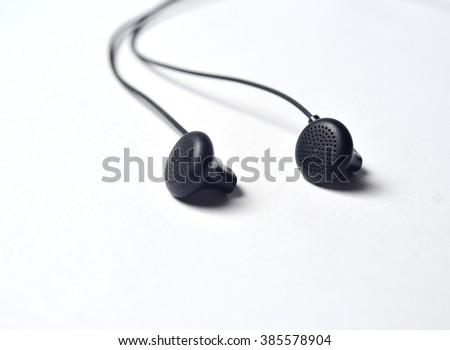 Black headphones on white background